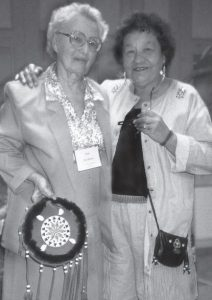 To demonstrate the OHS's appreciation for Jean Burnet's many years of service, the late Mary Lou Fox (right) of the Ojibwe Cultural Foundation, Manitoulin Island and a former OHS Board Member, conducted a special eagle feather ceremony at the 1995 OHS Annual Conference in Chatham. Mary Lou also handcrafted a beautiful leather shield which she presented to Jean. Photo: Rob Leverty