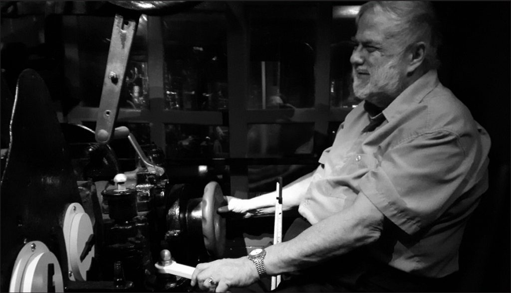 John Rae testing out a locomotive at the Canada Science and Technology Museum.