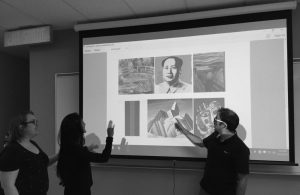 Students from the Algonquin College Museum Studies Program volunteer to describe art during John Rae's annual lecture.